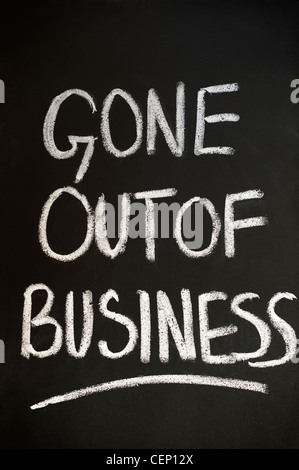 Blackboard with GONE OUT OF BUSINESS written on it in white chalk - Stock Photo