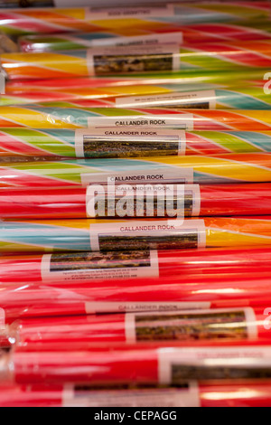 A stack of Rock sticks of candy a popular sweet in tourist areas. It is an old fashioned treat for children on holiday - Stock Photo