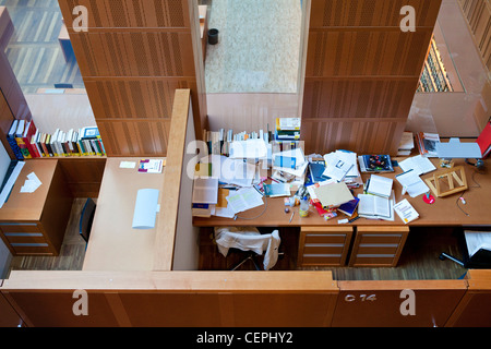 Two private reading/study rooms in a library. The contrasts of two different people can be seen, one untidy the - Stock Photo