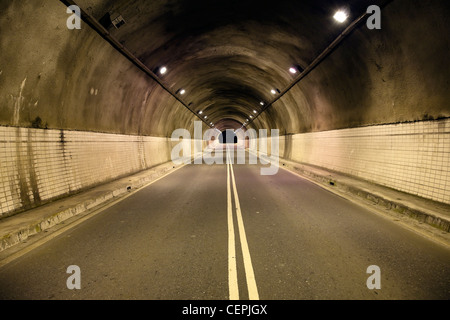 Night driving trough the old tunnel - Stock Photo