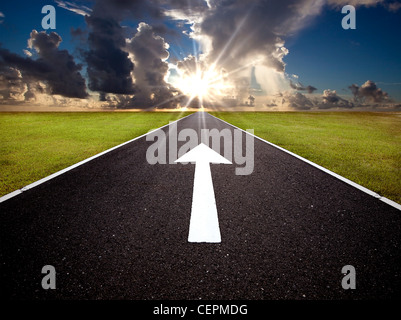 The road to the sunrise and forward mark - Stock Photo