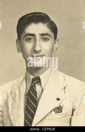 Archive Photo: Passport style photo of man in his twenties (1945) - Stock Photo