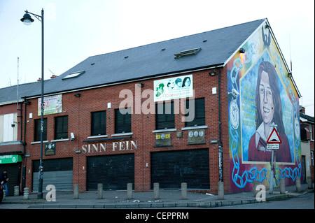 The Sinn Fein Headquarters and a political mural on Falls road. - Stock Photo