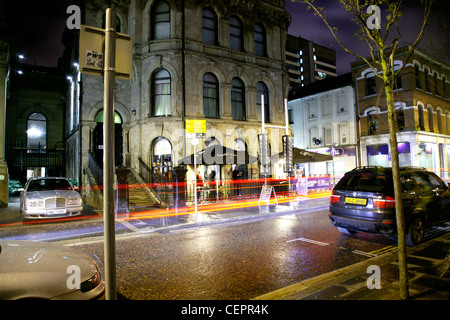 A night time view across the road to the Cloth Ear nightclub in Belfast. - Stock Photo