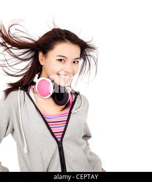 beautiful asian woman with headphones - Stock Photo