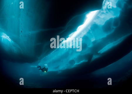 Ice Diving in Mountain Lake Sassolo, Sambuco Valley, Ticino, Switzerland - Stock Photo