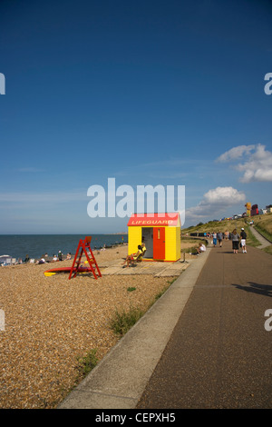 Two lifeguards sitting on duty outside their hut on the beach at Whitstable. - Stock Photo