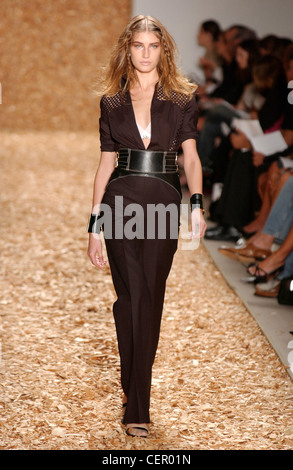 Anne Klein Ready to Wear New York spring summer fashion show Model long fair hair plaits wearing black catsuit sparkly - Stock Photo