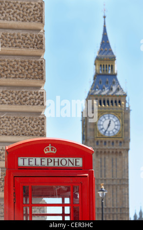 Iconic red telephone box in front of Big Ben in Westminster. - Stock Photo