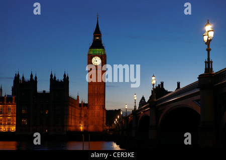 Houses of Parliament at night viewed from the South Bank. - Stock Photo