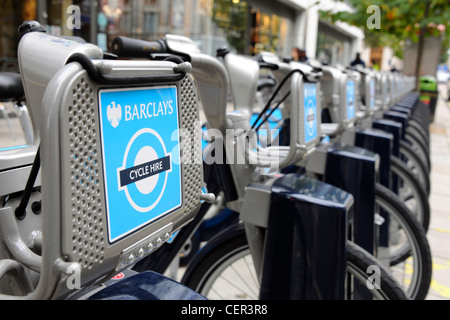 A Barclays Cycle Hire docking Station on Baker Street. - Stock Photo