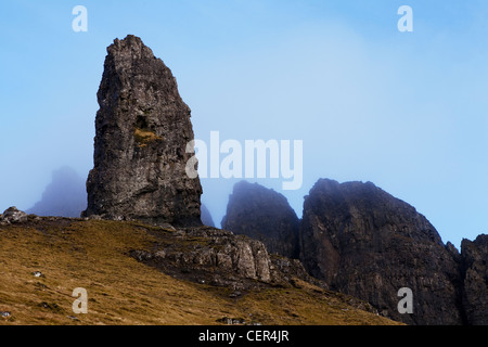 Mist hanging over the Old Man of Storr, dramatic pinnacles of rock remaining from ancient landslips on the Trotternish - Stock Photo