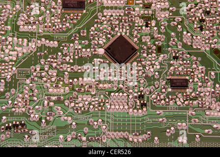 circuit board with chips and capacitors - Stock Photo