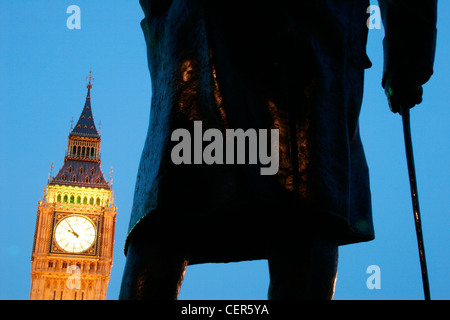 Big Ben framed by a statue of Winston Churchill. - Stock Photo