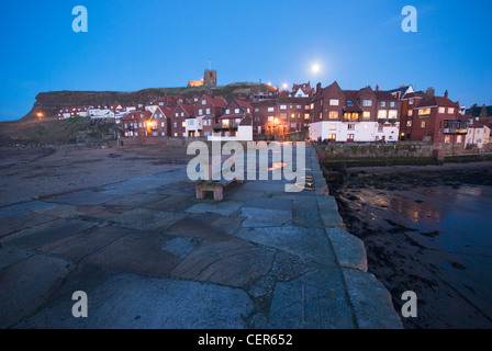 An evening view towards the old town of Whitby from the waterfront. - Stock Photo