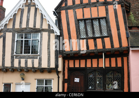 The Tudor facia of a terrace of houses in the Suffolk village of Lavenham. - Stock Photo