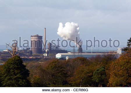 smoke and steam being emitted from the stacks in tata steel works - Stock Photo