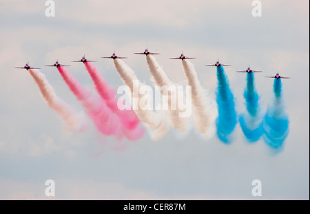 Royal Air Force Red Arrows aerobatic display team made up of British Aerospace Hawk T1 jet training aircraft performing - Stock Photo
