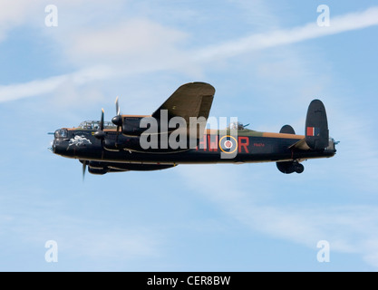 A preserved Royal Air Force Avro Lancaster B1 World War Two heavy bomber aircraft flying at RAF Fairford airbase - Stock Photo