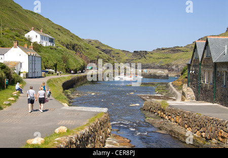 People walking along a path in the harbour village of Boscastle. - Stock Photo