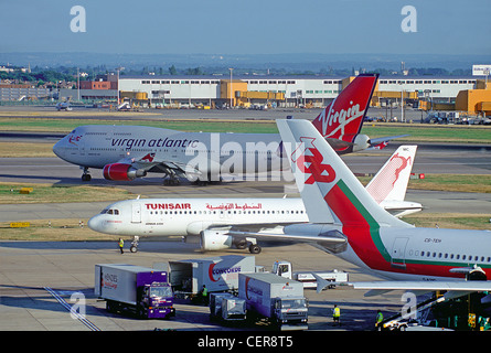 View of planes taxiing at Heathrow Airport from the former viewing terrace on top of the Queens building, due to - Stock Photo