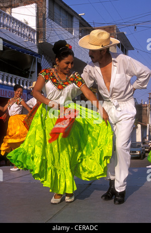 A Traditional Mexican Folkloric Dance Couple In Their