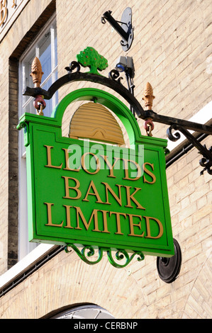An old fashioned Lloyds Bank Limited sign hanging outside a branch of the bank in Bury St Edmunds. - Stock Photo