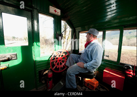 A train engineer driving an antique diesel locomotive on the Lake Whatcom Railway route in northwest Washington - Stock Photo