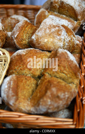 Fresh baked Bread for sale on a market stall - Stock Photo