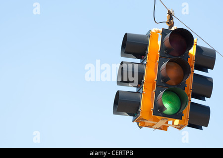 Green traffic signal or light in front of blue sky with copy space - Stock Photo