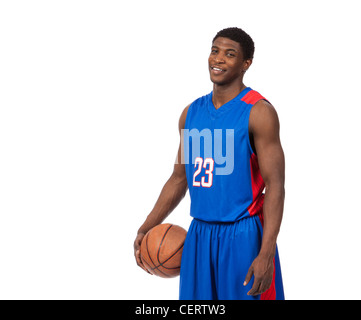 Male Basketball player in blue uniform on white background - Stock Photo