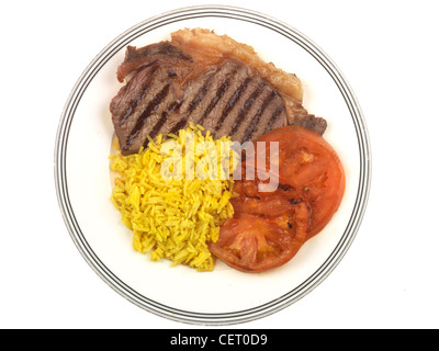 Freshly Grilled Sirloin Steak with Rice And Sliced Tomato Served On A Plate Against A White Background With No People - Stock Photo