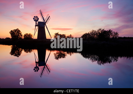Turf Fen drainage mill at sunset on the River Ant in the Norfolk Broads. - Stock Photo