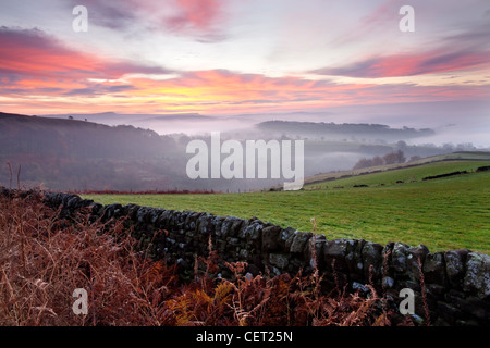 Autumn morning mist over the village of Hathersage in the Peak District National Park. - Stock Photo