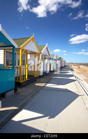 A row of colourful beach huts on the seafront at Southwold on a summers day on the Suffolk Coast. - Stock Photo