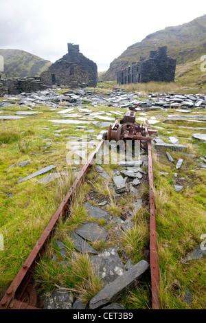 The remains of the abandoned Rhosydd Slate Mine high above Llyn Cwmorthin mine and Blaenau Ffestiniog in Snowdonia - Stock Photo