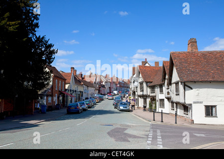 The main road running past historic half-timbered buildings in the village of Lavenham. - Stock Photo