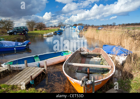 An angler fishing at Martham Staithe on the Norfolk Broads. - Stock Photo