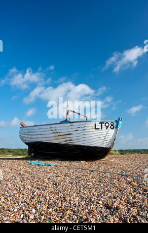 A weathered boat on Dunwich beach on the Suffolk Coast. - Stock Photo