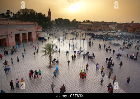 people in the Place Jemaa-el-Fna at dusk, Marrakech, Morocco - Stock Photo