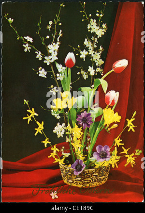 Easter postcard printed in Germany, shows the beautiful flowers in a vase, circa 1999. German Text: Happy Easter! - Stock Photo