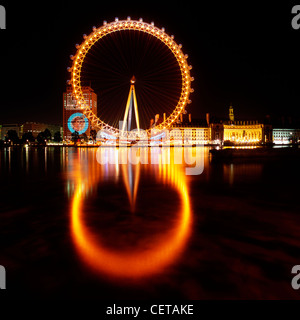 The British Airways London Eye at night. Opened in 1999, it stands at 135m tall making it the largest observation - Stock Photo