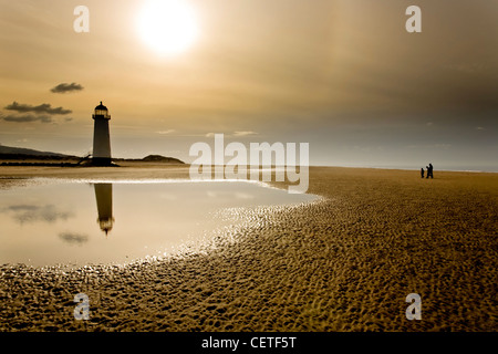A view from the beach at low tide to Talacre Lighthouse. - Stock Photo