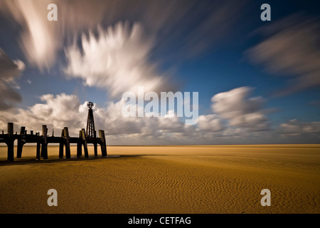 The end of an old wooden jetty at Lytham Saint Annes beach. - Stock Photo