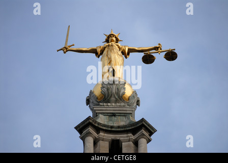 Statue of Lady Justice atop the Old Bailey building. The Central Criminal Court in England has been the setting - Stock Photo