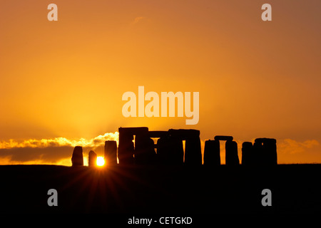 Stonehenge at sunset. Built around 3100 BC, it has been estimated that the three phases of the construction required - Stock Photo