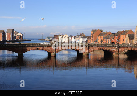 River Ayr with the New Bridge (built 1878) with the new river frontage high quality housing developments behind - Stock Photo
