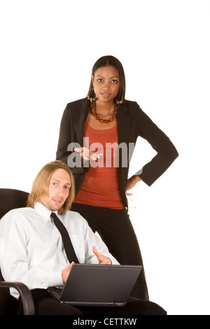 Caucasian young businessman holding portable notebook computer on his lap and ethnic businesswoman gesturing - Stock Photo