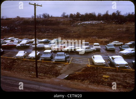 Cars parked in parking lot at Fort Wolters, Texas helicopter pilot training school during Vietnam War. 1965 mineral - Stock Photo