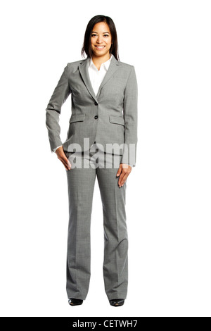 Asian business woman smiling confidently against white background - Stock Photo